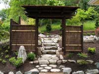 Japanese Wooden Gate entrance into Japanese Garden.