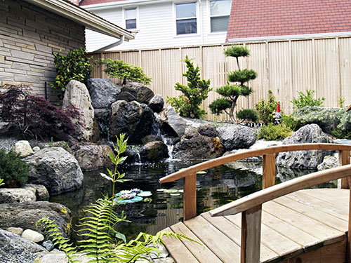 Zen japanese water garden designs water garden koi for Water pond design